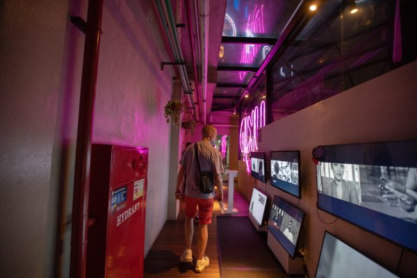 An audience member walks amid the video installation.